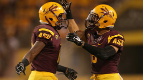 Wide receiver Ellis Jefferson (L) celebrates with running back D.J. Foster (R) against Weber State during the third quarter of Thursday's Sun Devil Stadium on August 28, 2014 in Tempe, Arizona. (Photo by Christian Petersen/Getty Images)