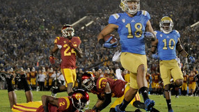 """<p>UCLA remains in control of the Pac-12 south with a <a href=""""http://pac-12.com/videos/highlights-ucla-football-controls-own-density-after-beating-usc-pasadena"""">dominating win over cross-town rivals USC.</a> <a href=""""http://pac-12.com/article/2014/11/22/ucla-football-eric-kendricks-one-hands-interception"""">The defense was opportunistic</a>, the offense was potent, and <a href=""""http://pac-12.com/videos/ucla-footballs-brett-hundley-builds-legacy"""">UCLA took down the Trojans for the third straight year.</a> UCLA can clinch the south division with <a href=""""http://pac-12.com/sport/football/standings"""">a victory over Stanford on Friday</a>. <a href=""""http://pac-12.com/football/event/2014/11/29/notre-dame-usc"""">The Trojans host Notre Dame</a>.</p>"""