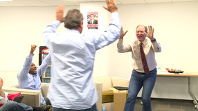 Rick Neuheisel and Nick Aliotti celebrate Jerry Neuheisel and UCLA's come-from-behind victory.