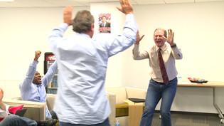 Jerry Neuheisel and Nick Aliotti high fives