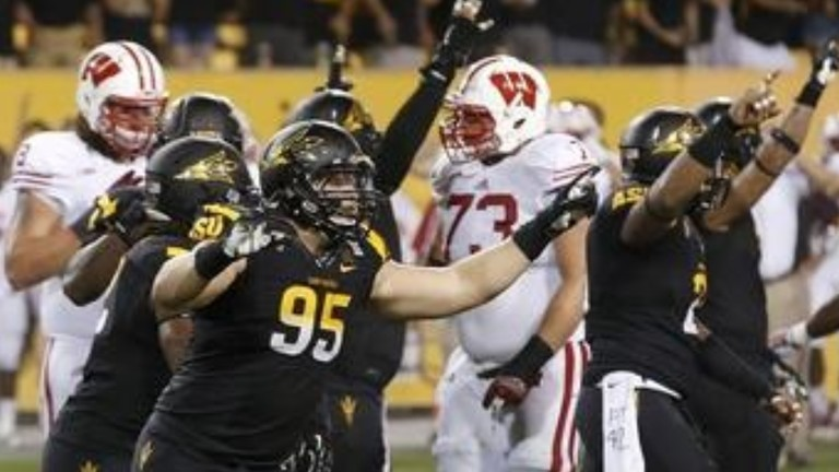 "<p><span style=""line-height: 1.6em;"">In case you missed the finish to the Sun Devils' win, </span><a href=""http://pac-12.com/videos/arizona-state-wisconsin-football-bizarre-ending"" style=""line-height: 1.6em;"" target=""_blank"">watch the jaw-dropping final seconds for yourself</a><span style=""line-height: 1.6em;"">. Taylor Kelly delivered 352 passing yards to carry Arizona State past</span> a strong Big Ten foe<span style=""line-height: 1.6em;"">. His team<a href=""http://pac-12.com/event/2013/09/21/arizona-state-stanford""> travels to Stanford for its conference opener</a> on Saturday, Sept. 21.</span></p>"