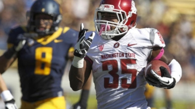 <p>Washington State running back Marcus Mason (35) runs for a touchdown past California safety Jason Gibson (9) during the first half of an NCAA college football game in Berkeley, Calif., Saturday, Oct. 5, 2013. (AP Photo/Tony Avelar)</p>
