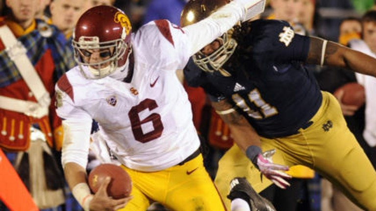 """<p><span style=""""line-height: 1.6em;"""">The Trojans outgained their rivals 330-295 in South Bend, but the</span><a href=""""http://pac-12.com/videos/highlights-usc-football-comes-short-against-notre-dame"""" style=""""line-height: 1.6em;"""" target=""""_blank"""">Irish defense outlasted USC</a><span style=""""line-height: 1.6em;"""">to end their five-game home losing streak to Troy. Ed Orgeron's squad converted two third-down conversions early but then went 0-for-11 over the rest of the game.</span><a href=""""http://pac-12.com/event/2013/10/26/utah-usc"""" style=""""line-height: 1.6em;"""" target=""""_blank"""">USC hosts Utah next weekend</a>.</p>"""