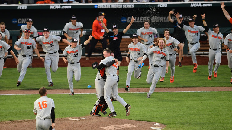 Oregon State baseball rushes the mound moments after Kevin Abel pitched a shutout vs. Arkansas in Game 3 to claim the program's third College World Series trophy.
