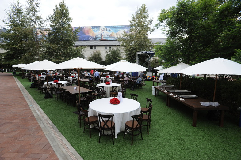 <p>Tables were set up in front of the podcast stage at the Pac-12 Football Media Day</p>
