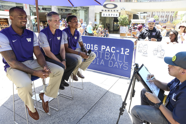 Darrell Daniels, Chris Petersen and Kevin King pose for the caricature artist.