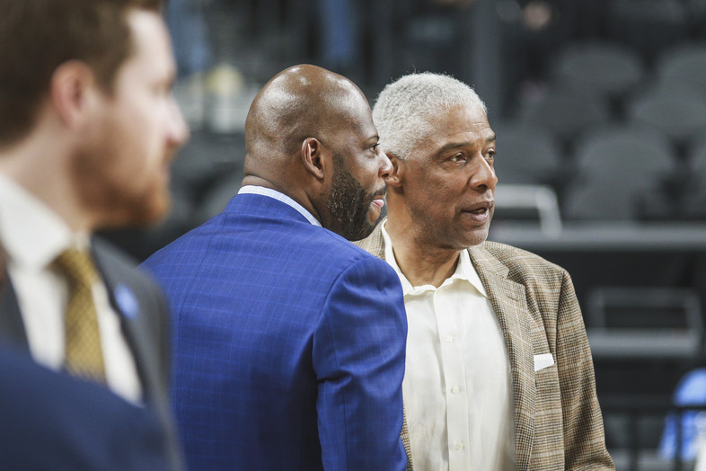 """Cal coach Wyking Jones talks with Julius """"Dr. J"""" Erving before Wednesday's game."""