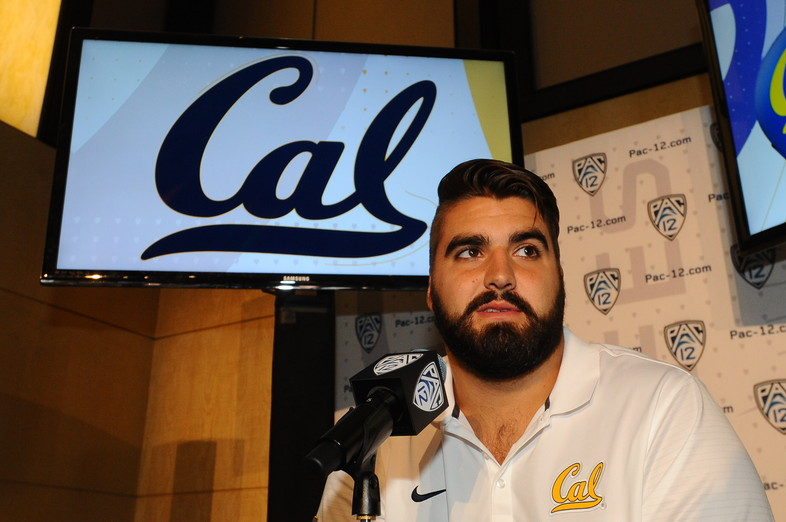 Cal offensive tackle Steven Moore takes questions at the podium.
