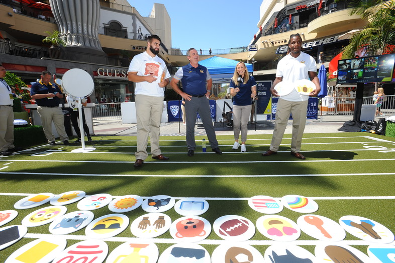 Steven Moore, Sonny Dykes, and DeVante Wilson figure out their emojis.