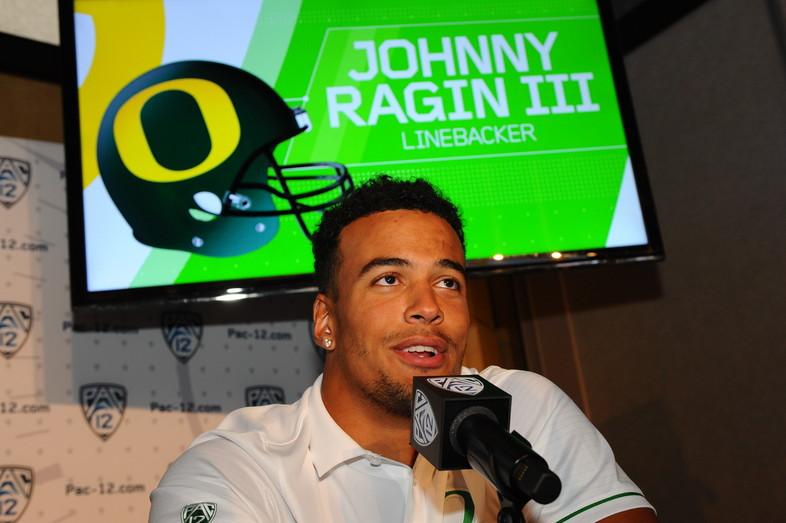 Oregon linebacker Johnny Ragin III speaks with reporters at Media Day.