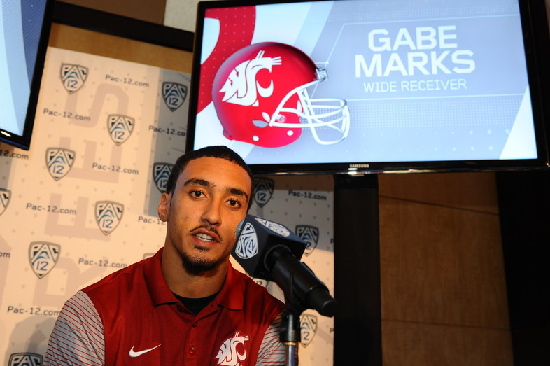Washington State receiver Gabe Marks answers a few questions at the podium.