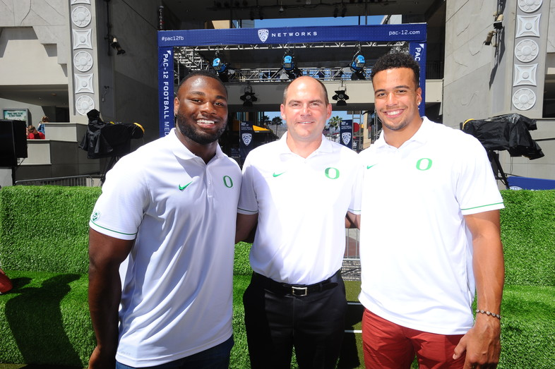Royce Freeman, Mark Helfrich, and Johnny Ragin III are all smiles at Pac-12 Football Media Days.