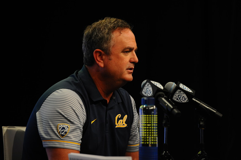 Cal head coach Sonny Dykes takes questions at the podium.