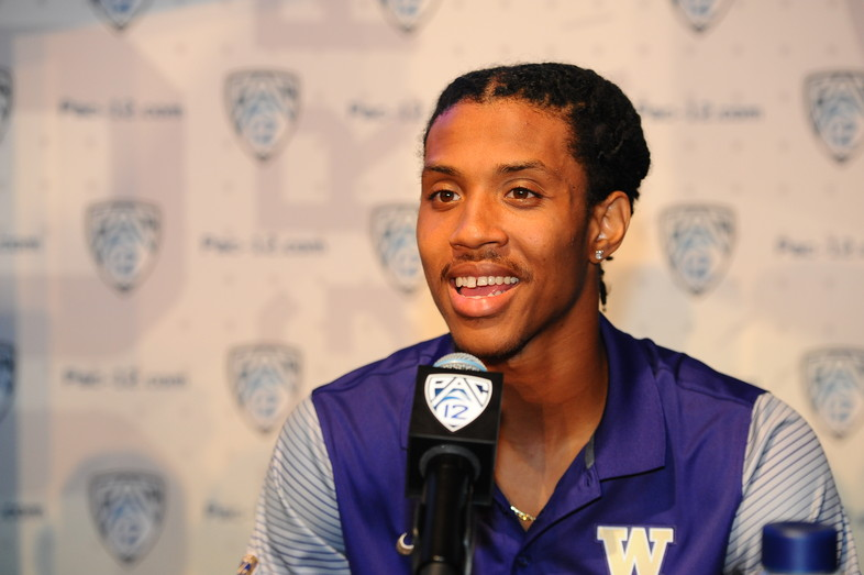 Washington defensive back Kevin King laughs it up with the media at the podium.