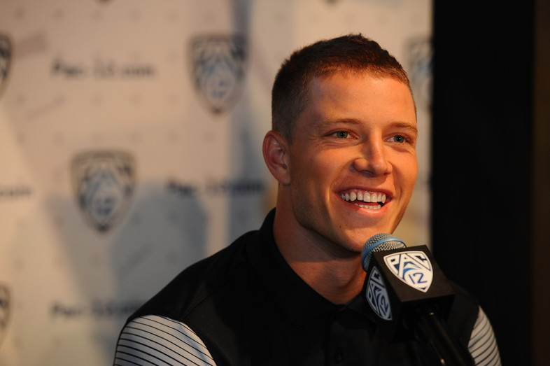 Stanford running back and record-breaker Christian McCaffrey chats with media members at the podium.