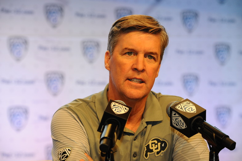 Colorado head coach Mike MacIntyre chats with media at the podium.