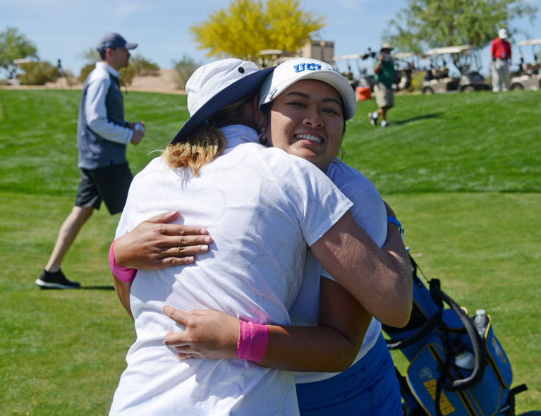 Pac-12 individual champion Lilia Vu of UCLA hugs head coach Carrie Forsyth