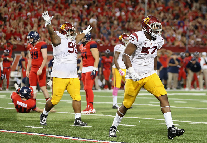 "<p>For one week, the undefeated Wildcats were the toast of the Pac-12…but it came crashing down Saturday night <a href=""http://pac-12.com/videos/highlights-usc-football-escapes-tucson-victory-against-arizona"">from a spirited Trojans squad</a>. <a href=""http://pac-12.com/article/2014/10/11/javorius-allens-200-yard-game-carries-usc-win-tucson"">Led by Buck Allen's 205 yards and three touchdowns</a>, the Trojans kept themselves in the Pac-12 South race, and threw another wrench into the College Football Playoff picture. <a href=""http://pac-12.com/football/event/2014/10/18/colorado-usc"">USC hosts Colorado next week,</a> while Arizona has a bye.</p>"