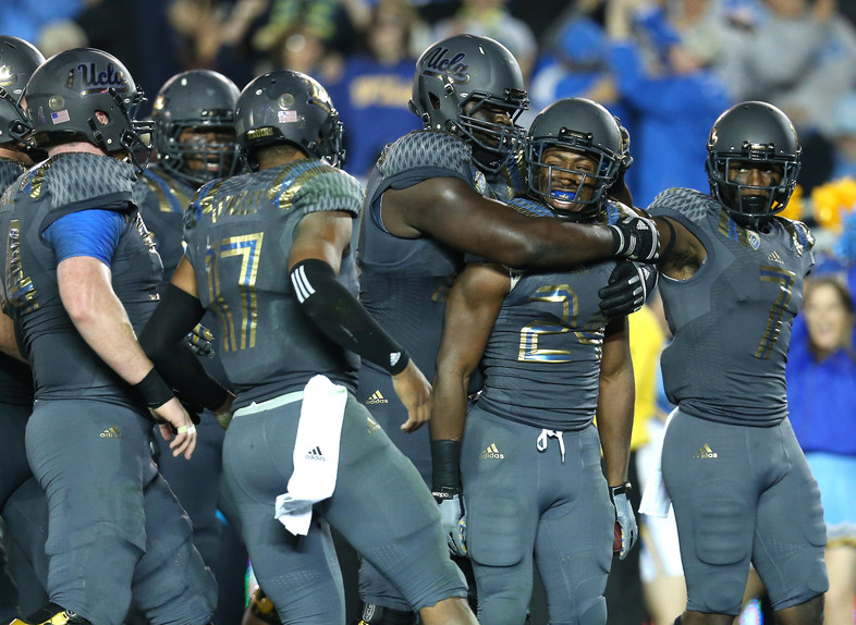 """<p><a href=""""http://pac-12.com/videos/ucla-jaleel-wadood-after-upsetting-arizona-we-played-our-hearts-out"""">The Bruins defense showed up in a big way Saturday</a>, <a href=""""http://pac-12.com/videos/ucla-jaleel-wadood-after-upsetting-arizona-we-played-our-hearts-out"""">Brent Hundley tied the school record for passing touchdowns</a>and UCLA remained in <a href=""""http://pac-12.com/sport/football/standings"""">contention for a Pac-12 South title.</a> <a href=""""http://pac-12.com/videos/recap-no-22-ucla-football-triumphs-over-no-12-arizona"""">The Bruins took down a high-flying Arizona squad</a>thathad scored at least 26 points in every game this season. Hundley led the Bruins with 131 yards rushing. <a href=""""http://pac-12.com/football/event/2014/11/08/ucla-washington"""">UCLA travels to Washington</a> next week, while the <a href=""""http://pac-12.com/football/event/2014/11/08/colorado-arizona"""">Wildcats host Colorado.</a></p>"""