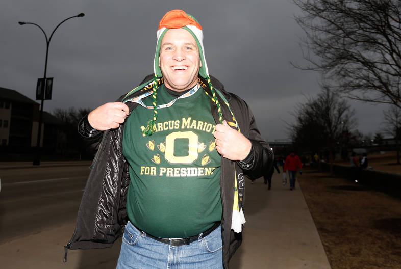 <p>Oregon fans have their game faces on.</p>