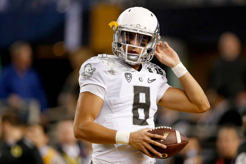 <p>Marcus Mariota warms up on the field before the National Championship.</p>