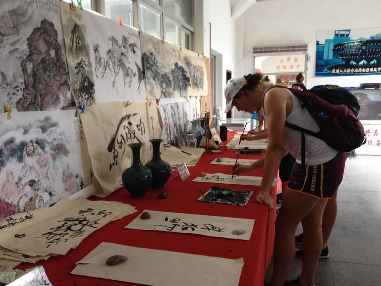 <p>Arizona State middle blockerWhitney Follette tried her hand at Chinese caligraphy during an outing Friday near Sanming.</p>