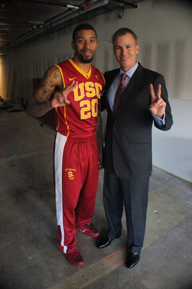 <p>USC senior guard J.T. Terrell (left) rocks his Nike kicks while head coach Andy Enfield (right) sports his dress shoes.</p>