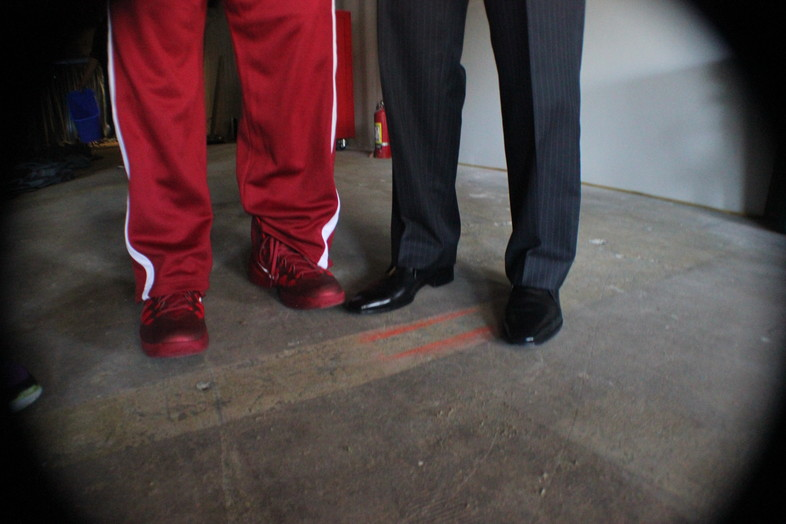 <p>USC senior guard J.T. Terrell's (left) Nike kicks and head coach Andy Enfield's (right) dress shoes.</p>