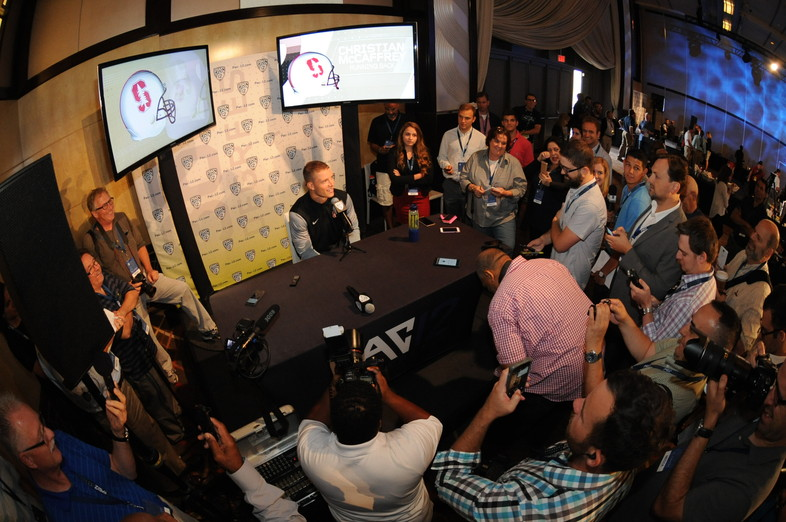 Christian McCaffrey faces a swarm of reporters at Media Day.