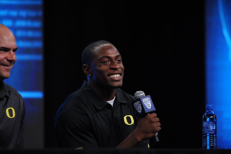 <p>Oregon head coach, Mark Helfrich and cornerback, Ifo Ekpre-Olomu share a laugh at the 2013 Pac-12 Football Media Day.</p>