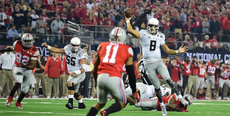 <p>Mariota caps off Oregon's opening drive with a touchdown pass to Keanon Lowe.</p>