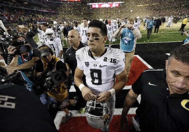<p>An emotional Mariota leaves the field after the loss.</p>