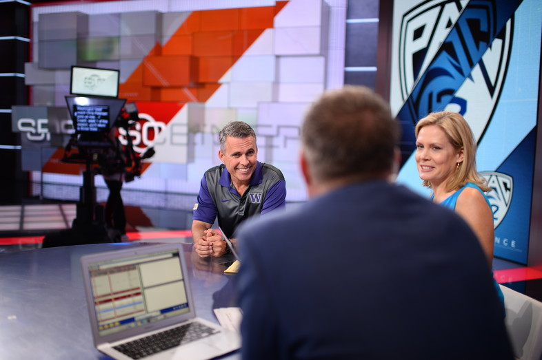 Washington head coach Chris Petersen soaks in the spotlight on the set of SportsCenter in Bristol, CT.