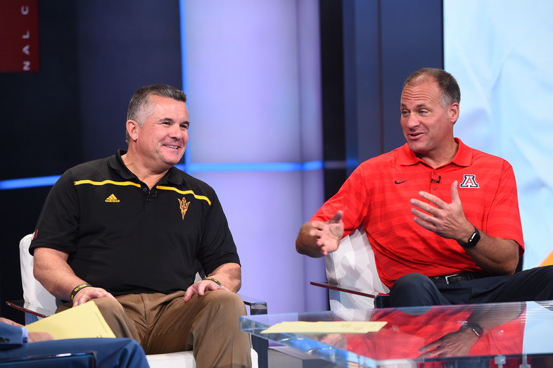 Arizona's Rich Rodriguez and Arizona State's Todd Graham compare notes while on the set of SportsCenter in Bristol, CT.
