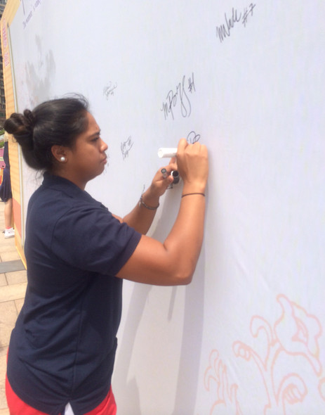 <p>Arizona's Penina Snuka was just one the Pac-12 all-stars who signed autographs Thursday for members of the Sanming community.</p>