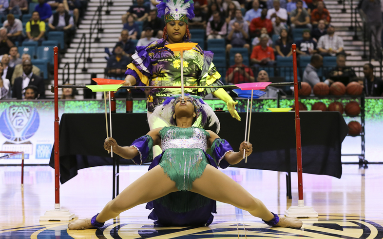 Plate spinning is risky business. Plate spinning while performing the traditional Trinidadian limbo? That's on another level. How low can she go?
