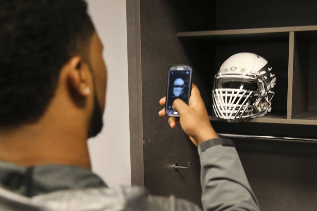 <p>Oregon Ducks checking out their game jerseys.</p>