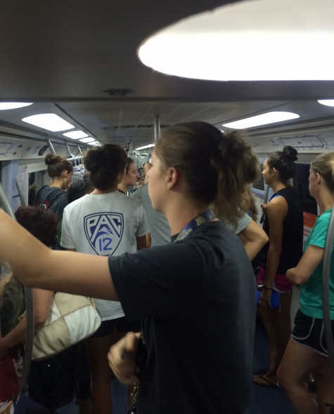 <p>The Pac-12 all-stars use the subway to travel between the arena and their hotel Tuesday in Beijing.</p>
