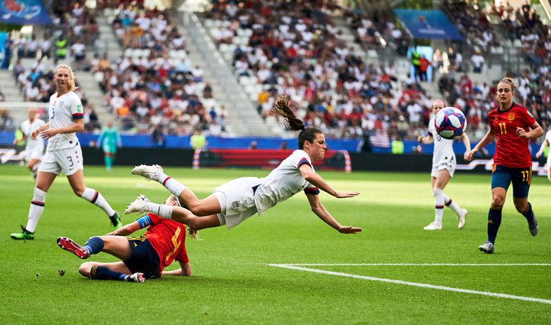 USA's Kelley O'Hara is tackled by Spain's Irene Paredes (bottom) Spain v United States - FIFA Women's World Cup 2019 - Round of 16 - Stade Auguste-Delaune II. June 24, 2019.