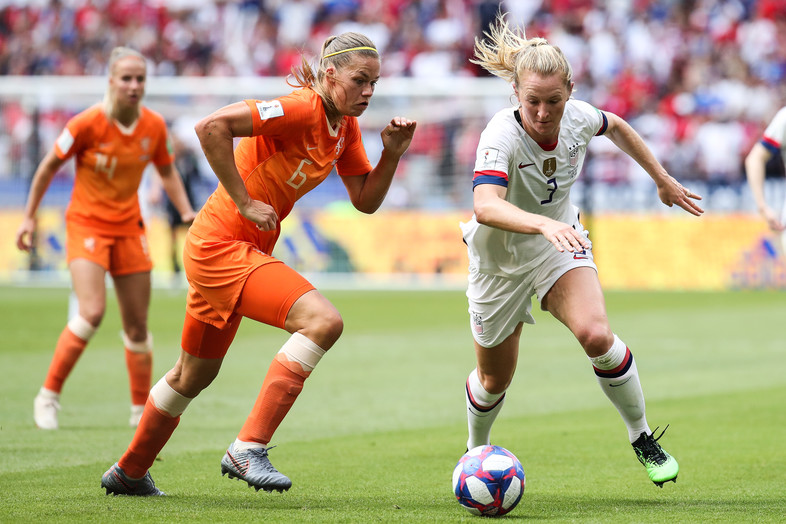 Samantha Mewis of USA competes for the ball with #6 Anouk Dekker of Netherlandsduring the 2019 FIFA Women's World Cup France Final match between The United State of America and The Netherlands at Stade de Lyon on July 07, 2019 in Lyon, France.