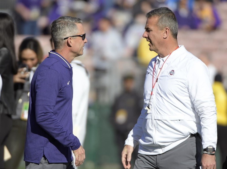 Washington head coach Chris Petersen talks with Ohio State head coach Urban Meyer prior to kickoff.
