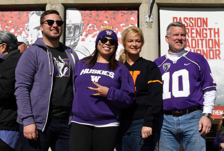 Washington fans gear up to cheer on their Huskies.