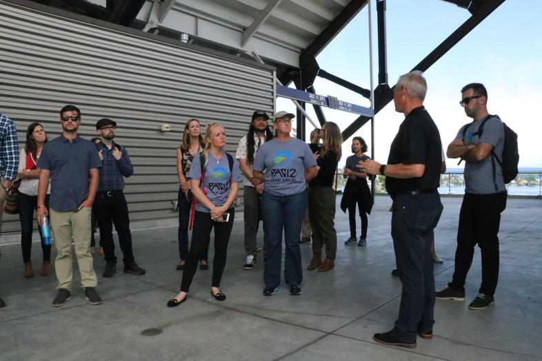 Chip Lydum, Associate Athletic Director for Washington, leads a sustainability tour of Husky Stadium on Tuesday.