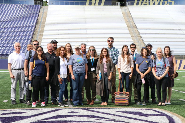 The Husky Stadium Sustainability Tour on Tuesday ends with a photo on the field.