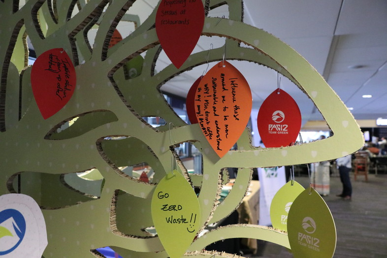Attendees wrote sustainability pledges and goals on the Pac-12 Team Green tree near the main entrance.