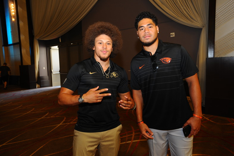 <p>Colorado's Phillip Lindsay and Oregon State's Manase Hungalu</p>