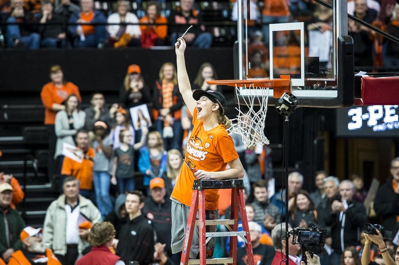 <p>Oregon State's Sydney Wiese cuts down the nets after clinching the Pac-12 regular season title.</p>