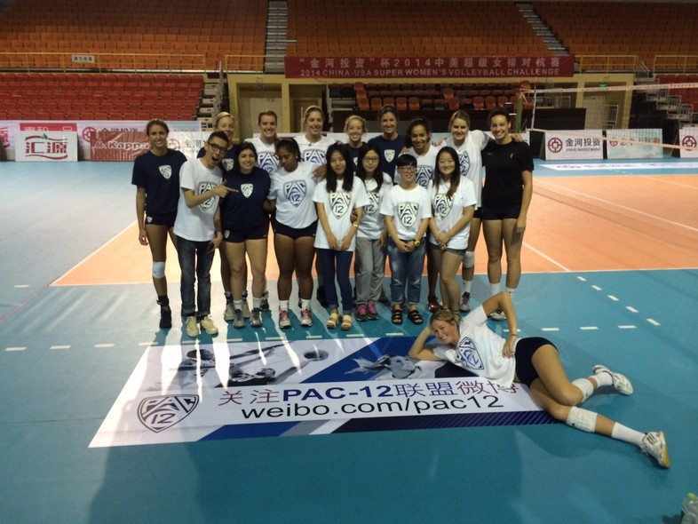 <p>Members of the Pac-12 all-star team pose with local college students before Tuesday's practice in Beijing.</p>