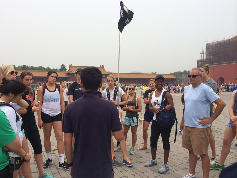 <p>The Pac-12 all-stars learn about Beijing's historic Forbidden City from a tour guide Wednesday.</p>