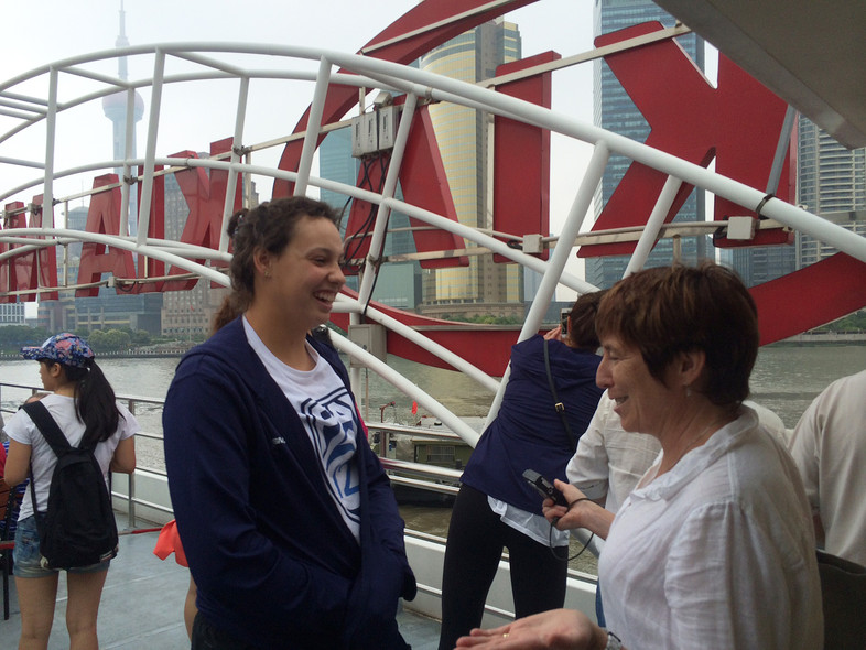 <p>Arizona State's Whitney Follette chats with a fellow Canadien while seeing the sights Tuesday in Shanghai.</p>